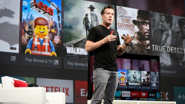 Dave Burke, director of engineering for Android, announces the Android TV during his keynote address at the Google I/O developers conference in San Francisco June 25, 2014.  REUTERS/Elijah Nouvelage   (UNITED STATES - Tags: BUSINESS SCIENCE TECHNOLOGY) - RTR3VQFQ