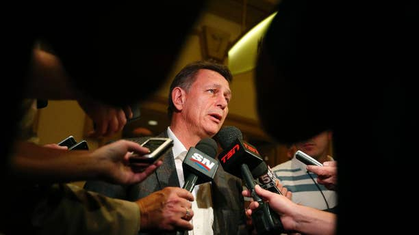 Detroit Red Wings general manager Ken Holland speaks with the media after a meeting of NHL hockey general managers Tuesday, June 23, 2015, in Las Vegas. (AP Photo/John Locher)