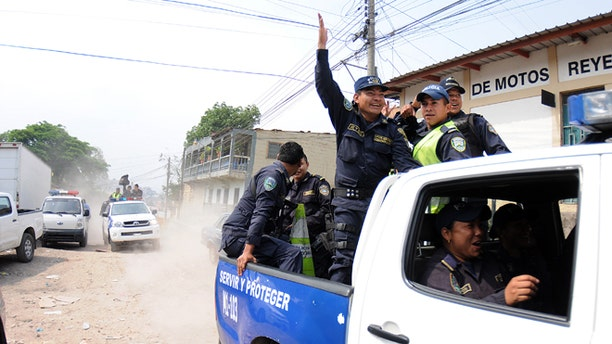 Honduras national policemen arrive at a police district after a work stoppage was declared in Tegucigalpa, Honduras, Tuesday April 23, 2013. About 1800 policemen have started a work stoppage to demand that the government improve working conditions for the police. The work stoppage comes at a time when the national police is being strongly criticized for the poor results fighting crime with statistics that place Honduras as one of the most violent countries in the world, holding a homicide rate of 91 per 100,000 residents. (AP Photo/Fernando Antonio)