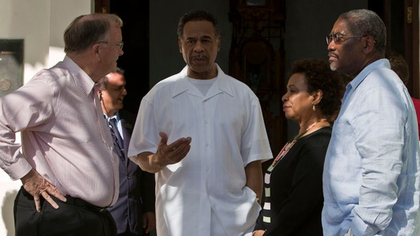 Congressman Emanuel Cleaver, center, speaks to Congressman Sam Farr, left, Congresswoman, Barbara Lee, second from right, and Congressman Gregory Meeks outside the Hotel Saratoga in Havana, Cuba, Monday, May 5, 2014. The congressmen had previously spoken at a press conference about imprisoned U.S. government subcontractor Alan Gross. (AP Photo/Franklin Reyes)