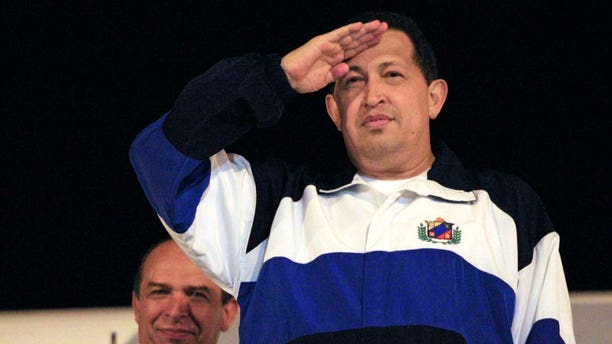 Venezuela's President Hugo Chavez salutes before his departure to Venezuela from the Jose Marti International Airport in Havana, Cuba, Monday July 4, 2011. Chavez returned to Venezuela from Cuba on Monday morning, stepping off a plane hours before dawn and saying he is feeling better as he recovers from surgery that removed a cancerous tumor. (AP Photo/Ismael Francisco, Prensa Latina)