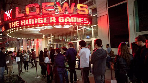 "March 22, 2012: Fans line up to see the midnight shows of ""The Hunger Games,"" at the 34th Street Loews AMC Theatre in New York."
