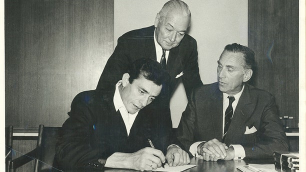 Johnny Cash, producer Don Law and Columbia Records president Goddard Lieberson, 1961.