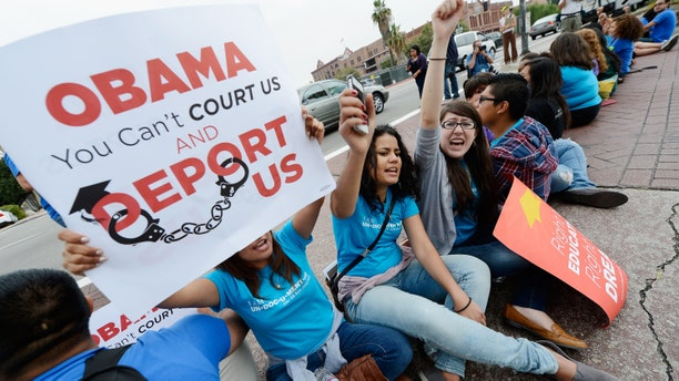 LOS ANGELES, CA - JUNE 15:  Students (L-R) Sarait Escorza, 23, Isabelle Vargas, 20, and Maricella Aguilar, 21, block the on ramp of US101 freeway during a demonstration by immigrant students for an end to deportations and urge relief by governmental agencies for those in deportation proceedings on June 15, 2012 in Los Angeles, California. In a policy change, the Obama administration said it will stop deporting young illegal immigrants who entered the United States as children if they meet certain requirements.  (Photo by Kevork Djansezian/Getty Images)
