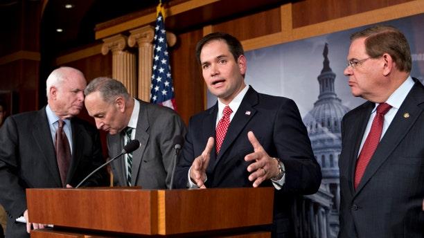 Sen. Marco Rubio, R-Fla., center, and Sen. Robert Menendez, D-N.J., far right.