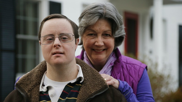 Matthew McMeekin, along with his mother, Bebe McMeekin, pose for a photograph at their home in Bethesda, Md. Most Americans with intellectual or developmental disabilities remain shut out of the workforce, despite changing attitudes and billions spent on government programs to help them.