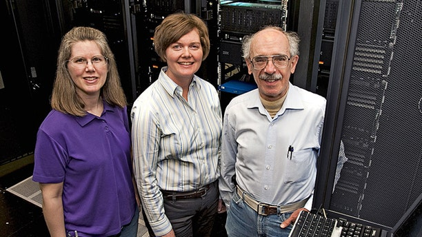 Iowa State University and Ames Laboratory researchers, left to right, Theresa Windus, Monica Lamm and Mark Gordon are working to scale up their computational chemistry tools for the Blue Waters supercomputer being developed at the University of Illinois and its National Center for Supercomputing Applications.