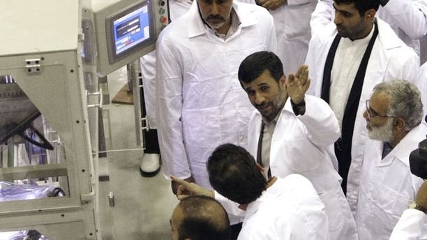 April 9, 2009: Iranian President Mahmoud Ahmadinejad, second right, gestures, as he visits Iran's Fuel Manufacturing Plant (FMP), a new facility producing uranium fuel for a planned heavy-water nuclear reactor, just outside the city of Isfahan, 255 miles south of Tehran, Iran.