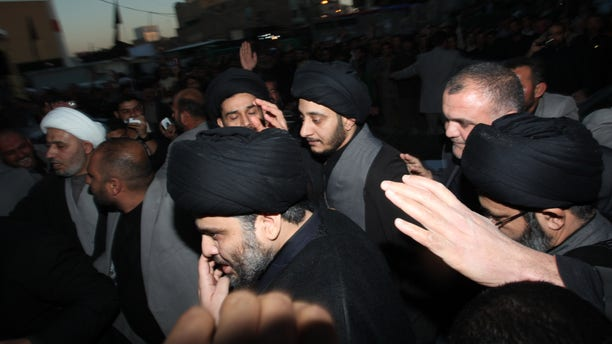 Jan. 5: Anti-American cleric Muqtada al-Sadr, center, is surrounded by supporters in the Shiite city of Najaf, Iraq. Muqtada al-Sadr has returned to Iraq after a nearly three-year absence.