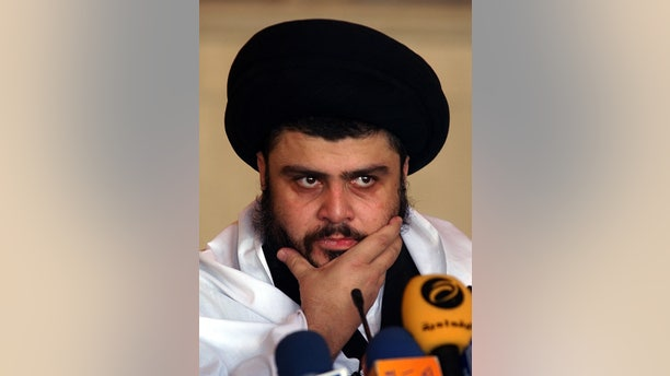 Sep. 22, 2006: In this file photo, Radical Shiite cleric Muqtada al-Sadr delivers a Friday sermon, in a Mosque, in Kufa, Iraq. Iraqi officials said al-Sadr returned to Iraq after a nearly 3-year absence.