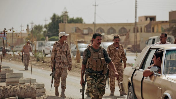Oct. 6: Armed Sunni militiamen work at a checkpoint in Samarra, Iraq. The men are part of the Sons of Iraq, who are former Sunni insurgents now allied with U.S. and Iraqi security forces to provide security in the northern city.