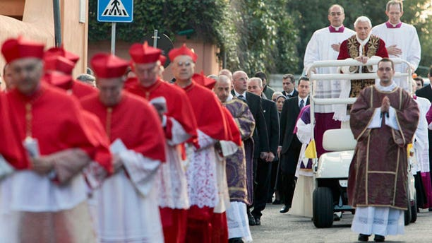 Feb. 22, 2012: Pope Benedict XVI attends a procession towards St.Sabina's church to celebrate the Ash Wednesday mass in Rome.