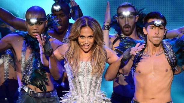 """Singer/actress Jennifer Lopez performs with dancers during her ongoing """"Dance Again"""" world tour."""