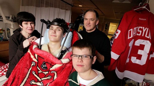 Jack Jablonski with his mother, Leslie, father Mike, and brother Max, at Hennepin County Medical Center in Minneapolis.
