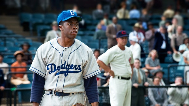 """This film image released by Warner Bros. Pictures shows Chadwick Boseman as Jackie Robinson in a scene from """"42."""" Kansas City's Negro Leagues Baseball Museum is hosting an advance screening of an upcoming movie about Jackie Robinson, who broke major league baseball's color barrier. Thomas Butch of the financial firm Waddell and Reed announced Wednesday, March 20, 2013, that actors Harrison Ford and Andre Holland will be among those appearing at an April 11 screening of """"42."""""""