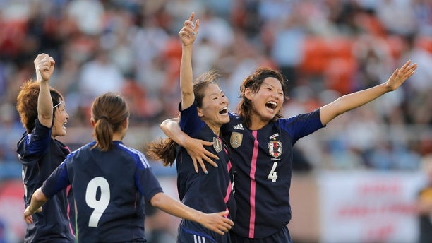 July 11, 2012: In this file photo, Japan's Homare Sawa, second right, celebrates after scoring their side's goal with teammates, Saki Kumagai (4), Nahomi Kawasumi (9), and Yuki Ogimi, left, against Australia during their friendly women's soccer match in Tokyo.