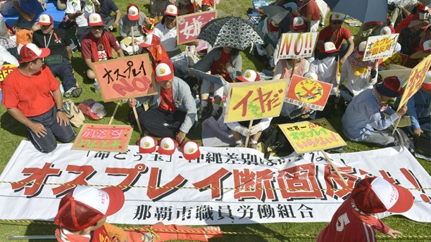 Sept. 9, 2012: Participants display banners against a planned deployment of Osprey aircraft during a rally in Ginowan, on the southern island of Okinawa, Japan.