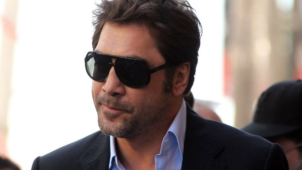 HOLLYWOOD, CA - APRIL 01: Actor Javier Bardem poses for photographers during the installation ceremony for actress Penelope Cruz's star on the Hollywood Walk of Fame on April 1, 2011 in Hollywood, California.  (Photo by Frederick M. Brown/Getty Images)