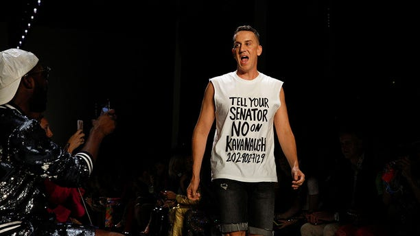 Fashion designer Jeremy Scott appears at the finale of the presentation of his spring 2019 collection during Fashion Week in New York, Thursday, Sept. 6, 2018.