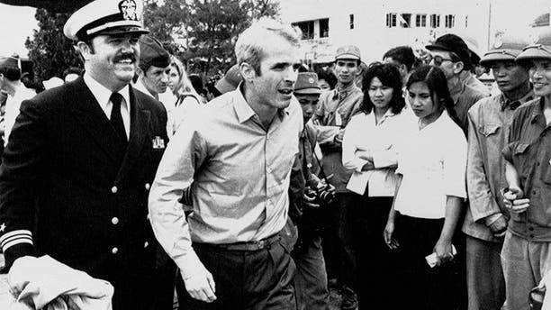John McCain escorted to Hanoi airport on March 14, 1973 after being released from prison