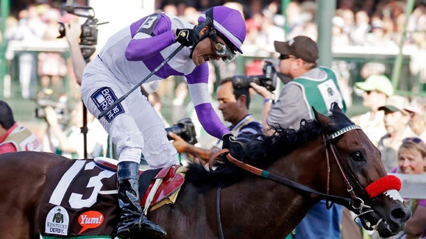 Mario Gutierrez celebrates after riding Nyquist to victory during the 142nd running of the Kentucky Derby horse race at Churchill Downs Saturday, May 7, 2016, in Louisville, Ky. (AP Photo/Garry Jones)