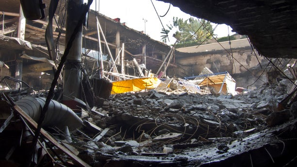 Sept. 28, 2013 - Rubble from the collapsed upper car park level covers buried vehicles in the basement car park, at the Westgate Mall in Nairobi, Kenya.