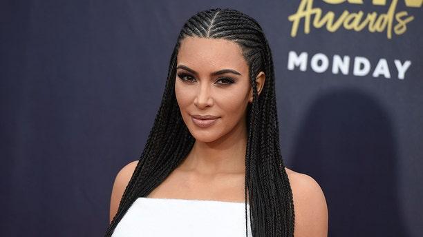 Kim Kardashian West arrives at the MTV Movie and TV Awards at the Barker Hangar on Saturday, June 16, 2018, in Santa Monica, Calif. (Photo by Jordan Strauss/Invision/AP)