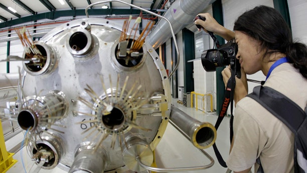 Aug. 7, 2010: A photographer takes a picture in the assembly room of the elements of the LHC (large hadron collider) at the European Particle Physics laboratory CERN in Geneva, Switzerland The world's biggest particle accelerator is about to start up again after a two-year shutdown and upgrade.