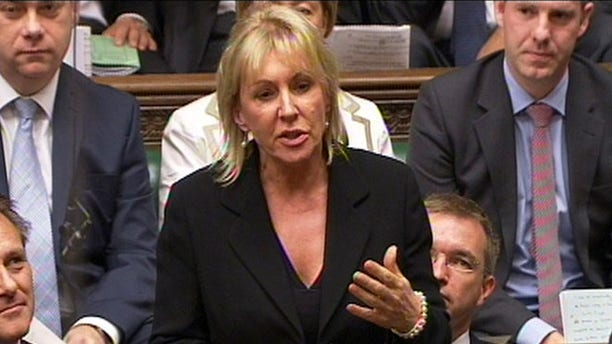 In this photo made from video on Sept. 5, 2012, Conservative MP Nadine Dorries talks during Parliament, in London.