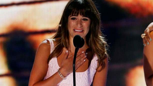 Actress Lea Michele accepts the Choice TV Actress: Comedy Award at the Teen Choice Awards at the Gibson amphitheatre in Universal City, California August 11, 2013.