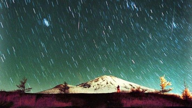 Leonid meteors are seen streaking across the sky over snow-capped Mount Fuji, Japan's highest mountain, early Monday Nov. 19, 2001, in this 7-minute exposure photo. Star gazers braved cold temperatures at the foot of Mount Fuji to observe the shower of Leonid meteors.
