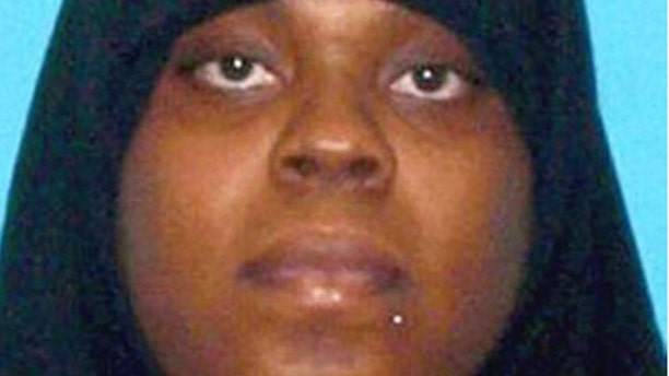 Latia Harris allegedly attacked a woman who was only protected by her 2-year-old son as bystanders did nothing.