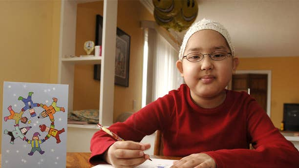 Gabriella Tirone , an 8-year old with leukemia, works on a drawing in her kitchen in Tonawanda, N.Y., Tuesday, Nov. 22, 2005. Tirone's artwork has been made into greeting cards, seen at left, by the Roswell Park Cancer Institute in Buffalo where she is a patient. (AP Photo/John Hickey)