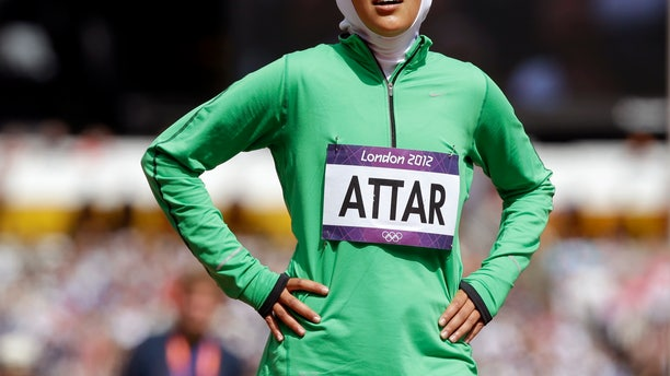 Saudi Arabia's Sarah Attar reacts after competing in a women's 800-meter heat during the athletics in the Olympic Stadium at the 2012 Summer Olympics, London, Wednesday, Aug. 8, 2012. Attar is the first Saudi woman to compete in athletics during the Olympics. (AP Photo/Anja Niedringhaus)