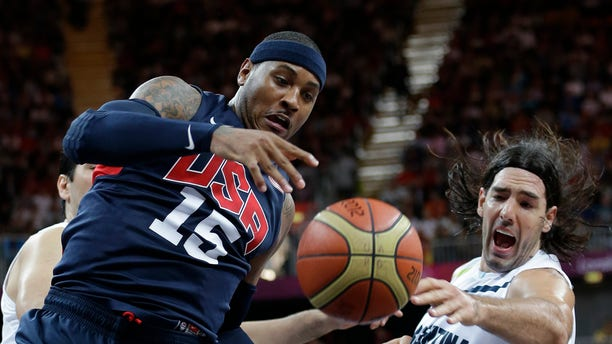 USA's Carmelo Anthony (15) and Argentina's Luis Scola, right, scramble for the ballduring a preliminary men's basketball game at the 2012 Summer Olympics, Monday, Aug. 6, 2012, in London. (AP Photo/Eric Gay)