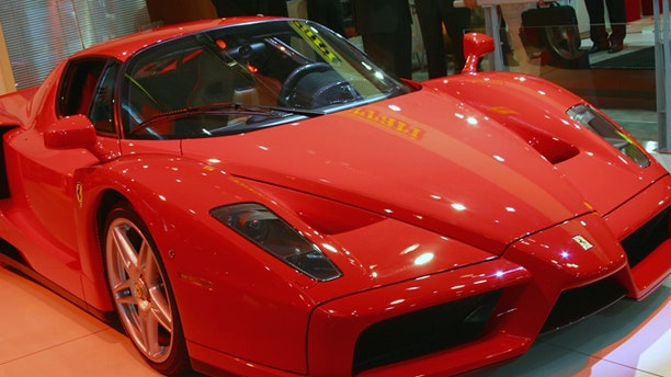 SYDNEY - OCTOBER 17:  The new Ferrari Enzo is revealed at the Sydney International Motor Show on October 17, 2002 in Sydney, Australia. The Enzo is modelled on Ferrari's F1 race cars and is the fastest production car in the world. More than 60 cars will be on debut at the Sydney International Motorshow showcasing the latest designs and future concepts from the world's leading Automotive companies. (Photo by Cameron J Spencer/Getty Images)