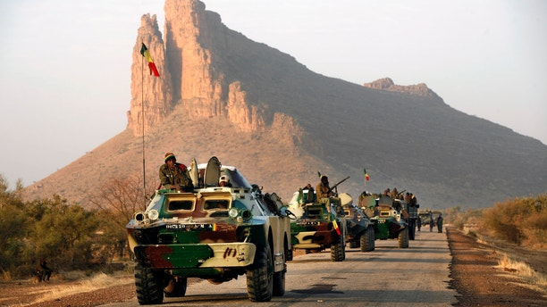 Feb. 4, 2013 - A convoy of Malian troops makes a stop to test some of their weapons near Hambori, northern Mali, on the road to Gao.