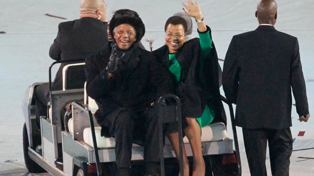 July 11: Former South African President Nelson Mandela waves to the crowd at the World Cup closing ceremonies. (AP)