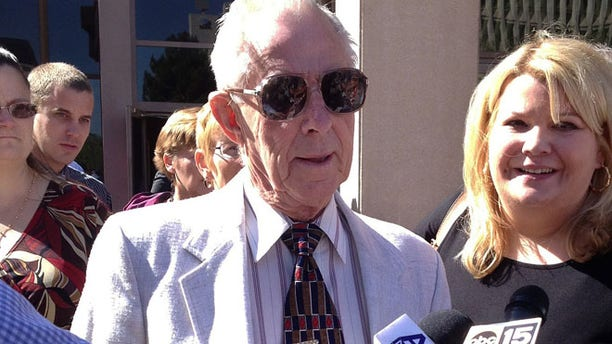 March 29: George Sanders, center, is joined by his attorney Janey Henze Cook, right, outside a Phoenix courtroom.