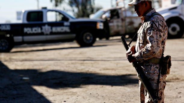 TIJUANA, MEXICO - OCTOBER 31:  Mexican security officials stand guard outside of a factory where a drug tunnel was discovered leading into the United States on October 31, 2013 in Tijuana, Mexico.  The tunnel was discovered last night just south of the Otay Mesa border crossing in a business park area.  (Photo by Sandy Huffaker/Getty Images)