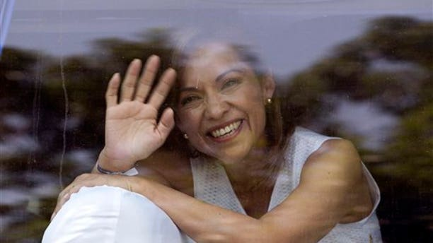 March 30, 2012: Josefina Vazquez Mota, presidential candidate for the now-governing National Action Party, PAN, waves to supporters through a car window in Mexico City.