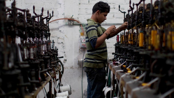 In this Feb. 29, 2012 photo, a worker uses a threading machine at the sombrero shop of Maria de la Luz Yepez, not shown, who is preparing three Mexican style sombreros to give as gifts to Pope Benedict XVI, in the town of San Francisco del Rincon, near Leon, Mexico. The visit of Pope Benedict XVI, his first to Spanish-speaking Latin America, begins on March 23 in Mexico's central state of Guanajuato, where he will spend three days and give an outdoor Mass before heading to Cuba on March 26.  (AP Photo/Dario Lopez-Mills)