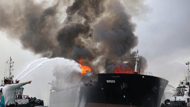 Firefighting boats extinguish a fire aboard the tanker Burgos in Boca del Rio, Mexico, Sept. 24, 2016.