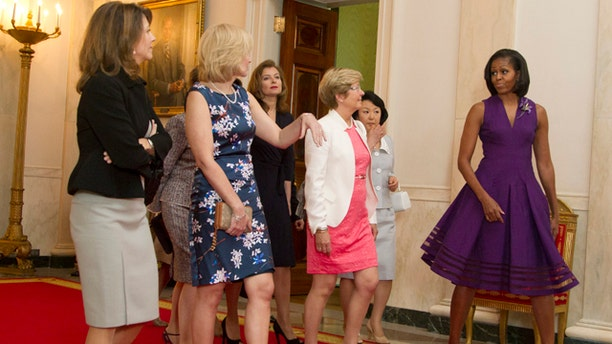May 19, 2012: First Lady Michelle Obama, right, walks with spouses of the G-8 leaders in the Grand Foyer of the White House in Washington during a White House tour.