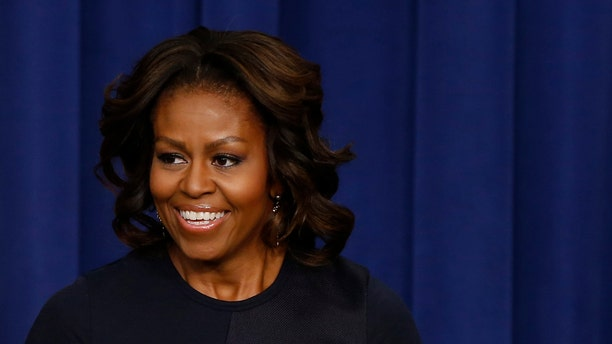 First lady Michelle Obama speaks in the Eisenhower Executive Office Building on the White House complex in Washington.