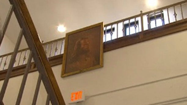 Feb. 7, 2013: Photo of a portrait of Jesus hangs in the hallway at Jackson Middle School.