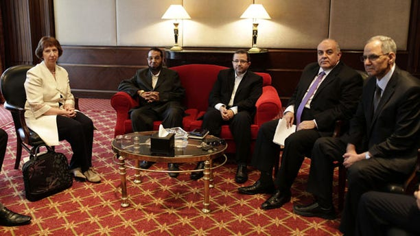 July 29, 2013: European Union foreign policy chief Catherine Ashton, left, meets with Mahmoud Taha, a leader in the Construction and Development Party, the political wing of the former Gamaa Islamiya militant group, second left, Hesham Kandil, former Egyptian Prime Minister, center, Amr Darrag, a member of the Muslim Brotherhood's Freedom and Justice Party, second right, Mohammed Ali Bishr, a member of the Muslim Brotherhood's leadership council, right, in Cairo. (AP Photo)