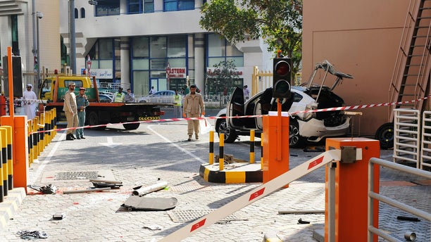 Jan. 26, 2015 - The scene after a car plunged 6 stories from a parking lot in Abu Dhabi, United Arab Emirates. State media says a 54 yo woman from Europe died after her car plunged from the parking lot in the capital.