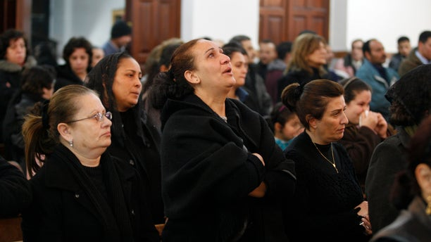 Jan. 5, 2011: An Egyptian Coptic woman, center, reacts during a prayer ceremony for the victims who died after New Year's Day church bombing that killed 21 people, at the Coptic Orthodox Church in Amman, Jordan.