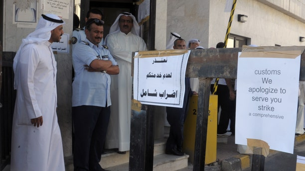 Employees of Kuwait's Customs gather at the Cargo terminal in Kuwait Airport demanding better pay in Kuwait, Monday, Oct. 10, 2011.